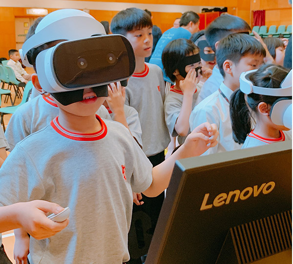 Lenovo Foundation child with VR headset
