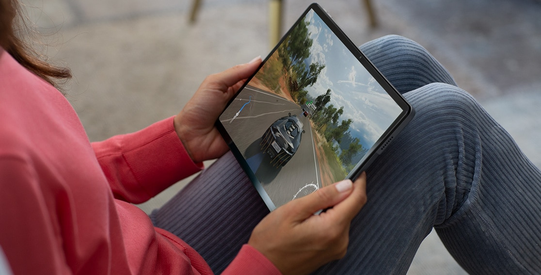 Front view of Lenovo Tab P11 tablet showing racing game