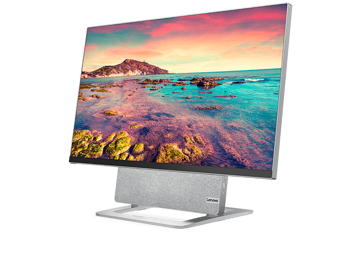 Yoga AIO 7 (27″ AMD) front view at left angle, screen on, picture of rocky seashore