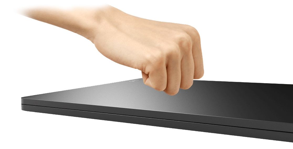 Lenovo Yoga Book C930 demonstrating knock-to-open feature