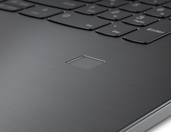 Detail of fingerprint reader on the Lenovo V320 laptop.