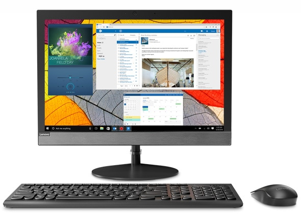 Lenovo V130 - Front-facing shot of the all-in-one with a series of images on screen, plus mouse and keyboard
