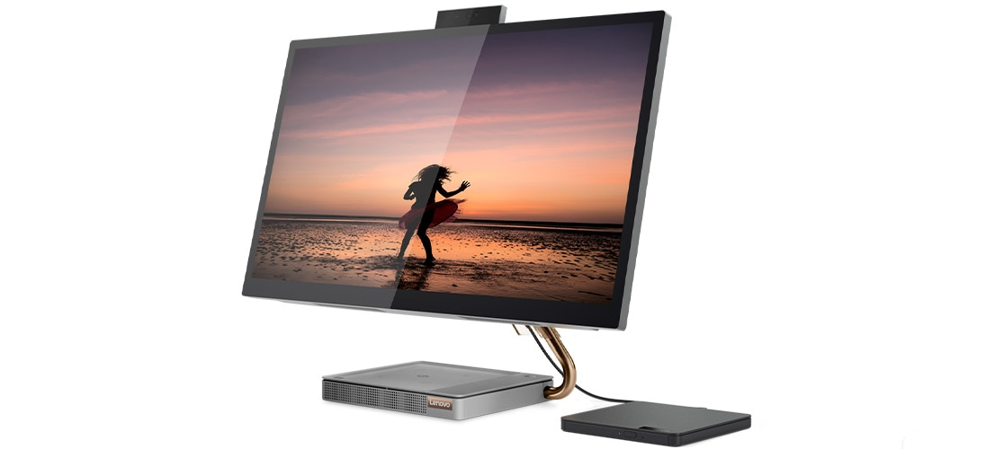 Side view of the IdeaCentre A540 (27), with an image of a woman on a beach, and back-up hard drive (sold separately)