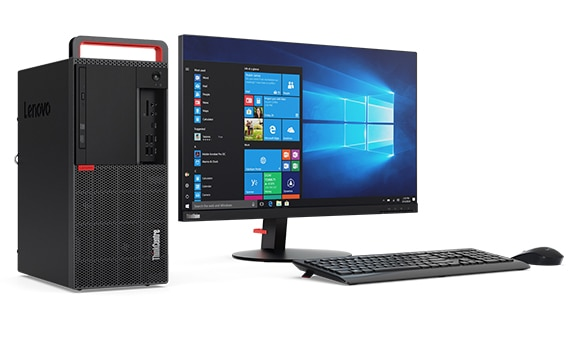 Side angled view of Lenovo ThinkCentre M920 Tower alongside monitor, wireless keyboard and mouse