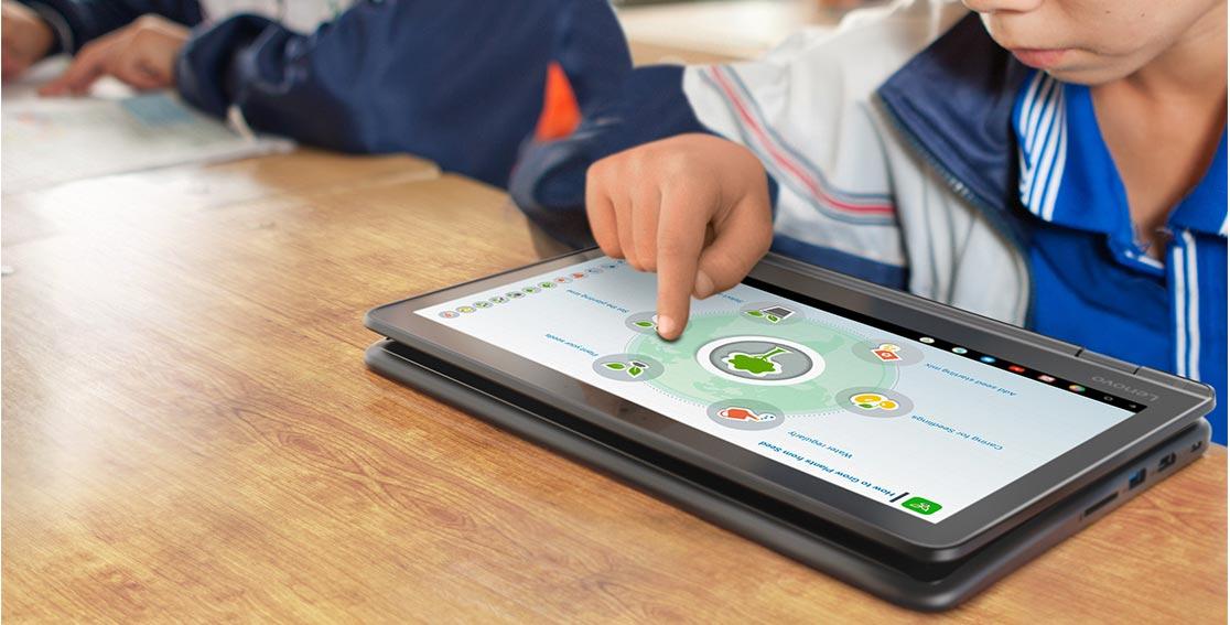 A child using a Lenovo 300e Chromebook at a desk