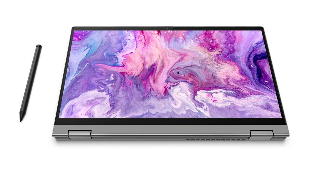 The platinum grey IdeaPad Flex 5 folded into a tablet with stylus