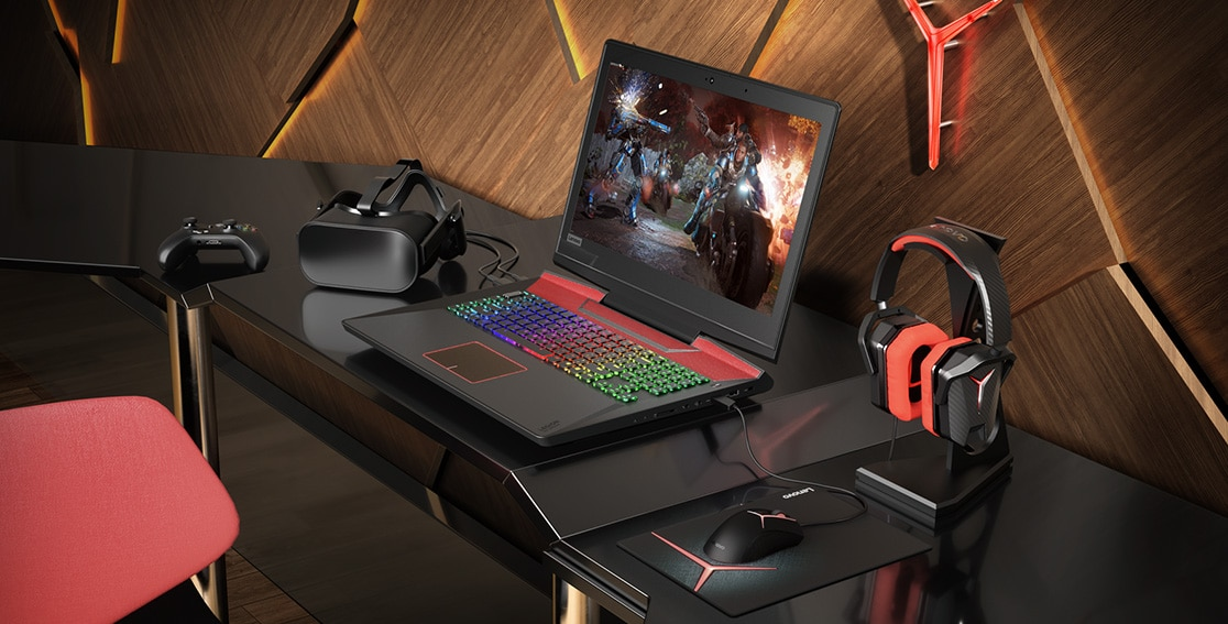 Lenovo Legion Y920 atop a desk and surrounded by numerous gaming accessories