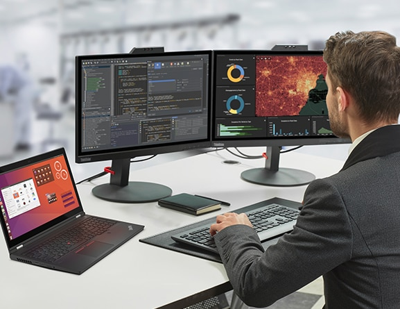 A man sits at a desk with the Lenovo ThinkPad P15 Gen 2 mobile workstation along with two large monitors displaying media and entertainment industry.