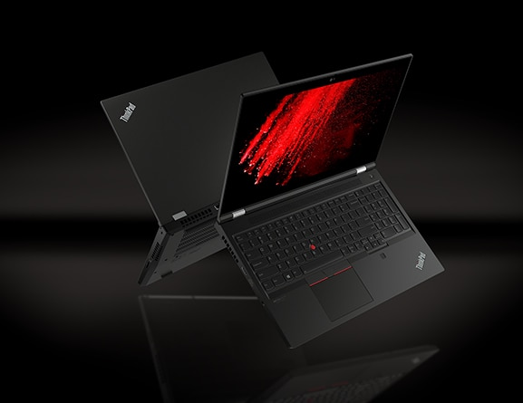 Two back-to-back Black Lenovo ThinkPad P15 Gen 2 laptops floating midair, open 90 degrees, showing keyboard, display, and partial back-side with burst of red color on screen.