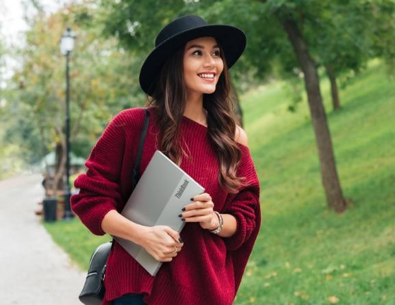 Woman carrying Lenovo ThinkBook 13s Gen 3 (13