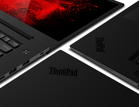 Shot of ThinkPad P1 open 180 degrees next to two ThinkPads with close-up of logo