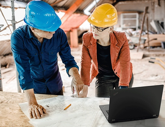 Shot of the ThinkPad P72 being used onsite by two builders / architects