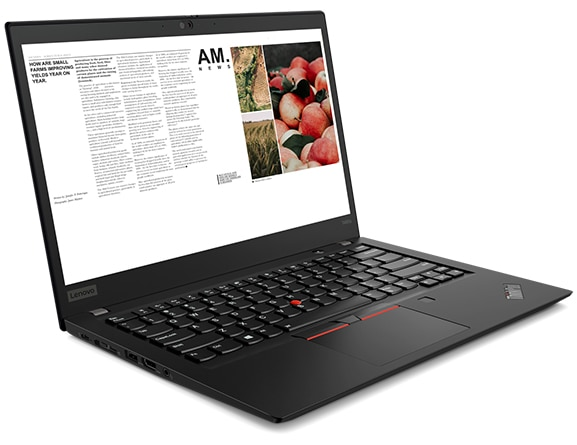 A ThinkPad T495s laptop with the screen open, showing an online newspaper article