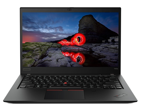 An opened ThinkPad T495s laptop, showing a dramatic volcanic scene with red flowing lava