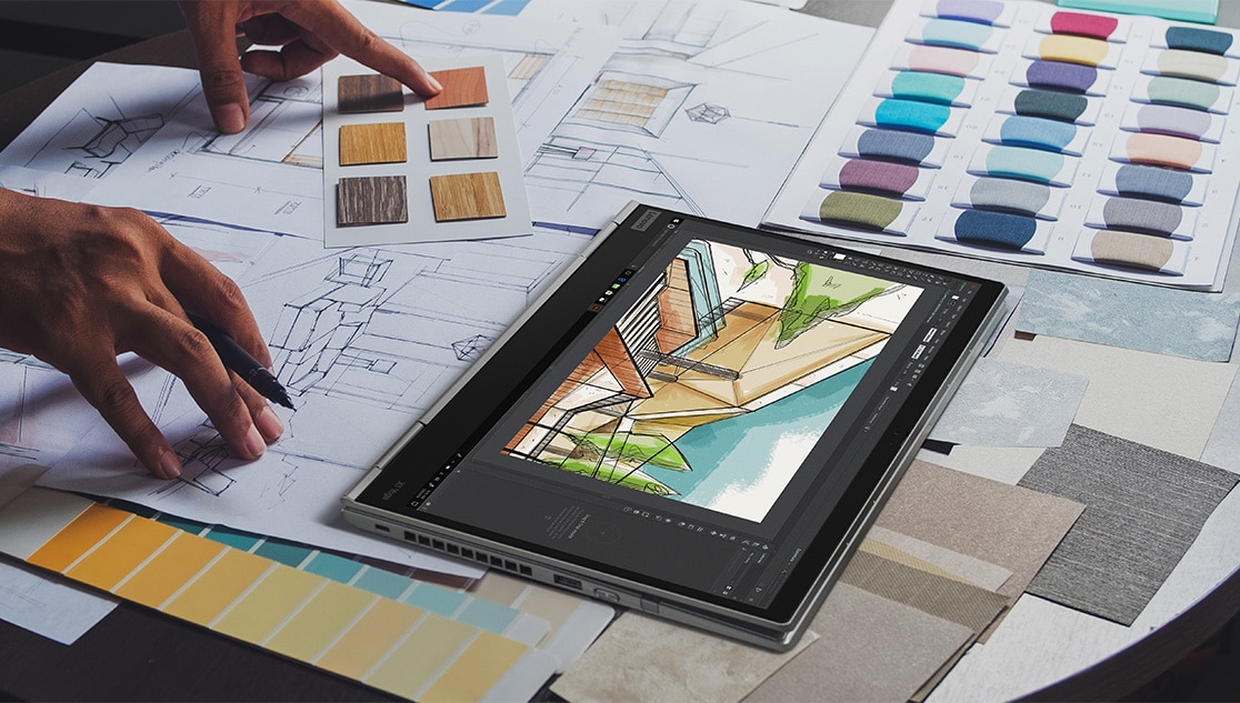 The Lenovo ThinkPad X1 Yoga Gen 4  in tablet mode, on a desk surrounded by color swatches.
