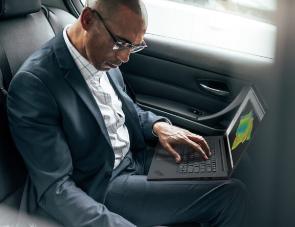 Lenovo ThinkPad P1 Gen 3 mobile workstation in use on a man's lap.