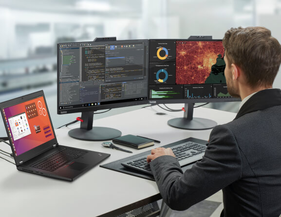 Lenovo ThinkPad P17 mobile workstation used alongside two supported monitors with an extended desktop.