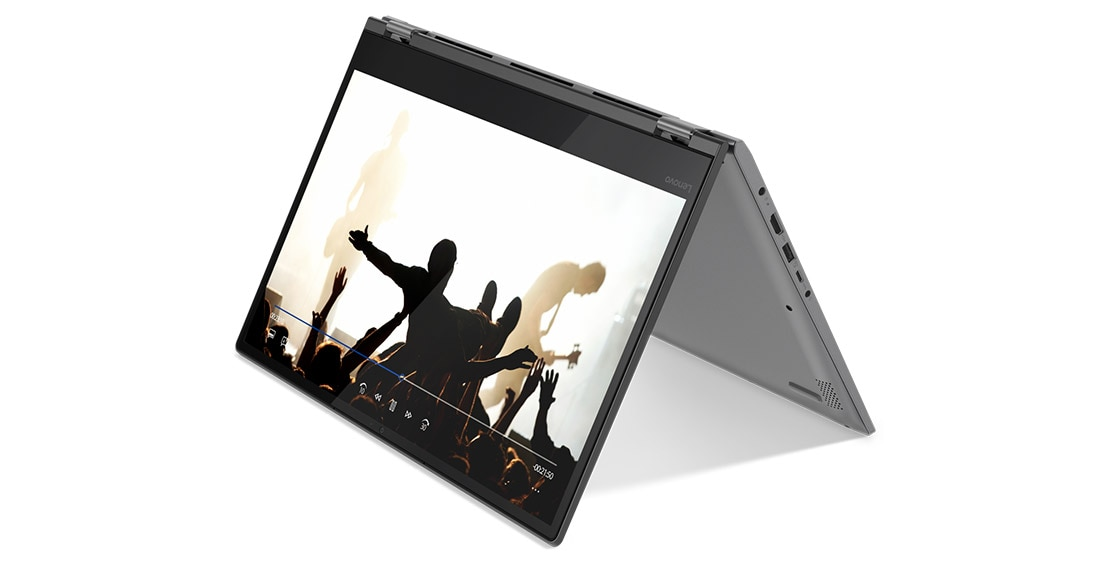 Lenovo Yoga 530 stylish 2-in-1 laptop, shown in Tent mode from 3/4 front, with concert footage