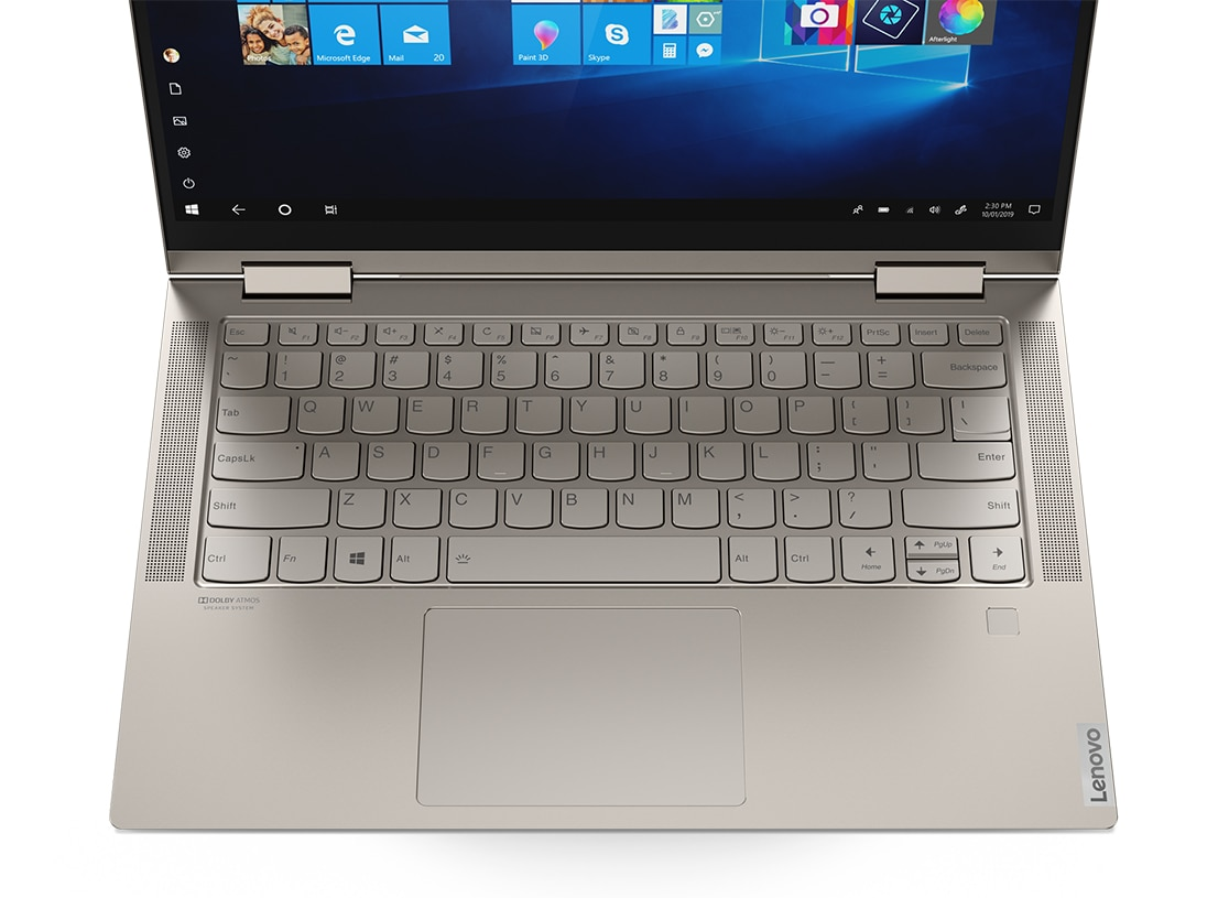 An Iron Grey Yoga C740 from above, showing the keyboard and front-facing speakers with Dolby Atmos®