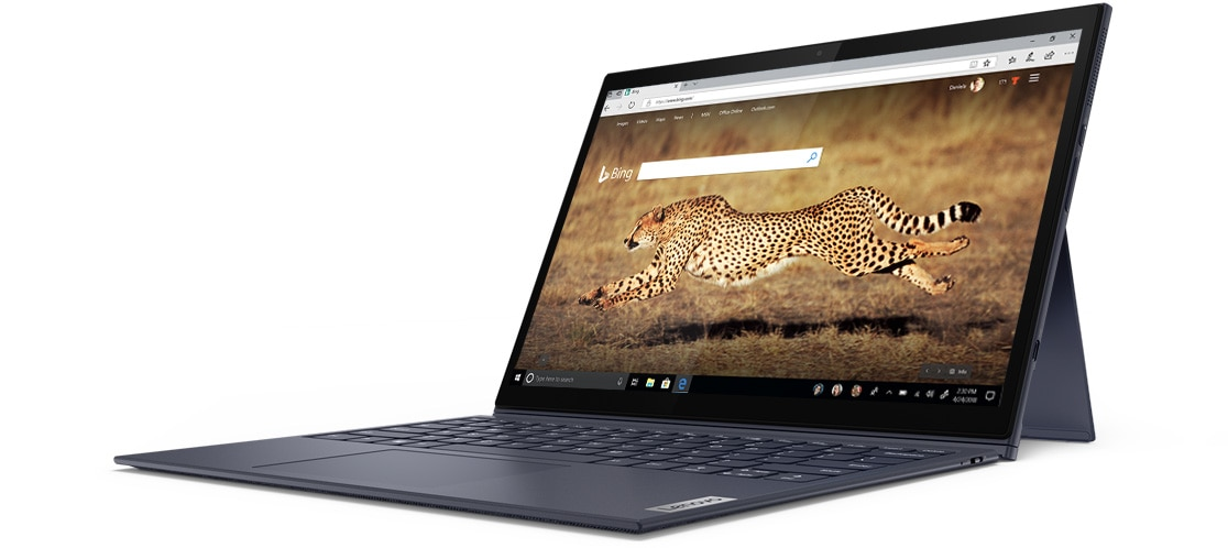 An open Yoga Duet 7i, showing the Bing browser and a running cheetah on screen