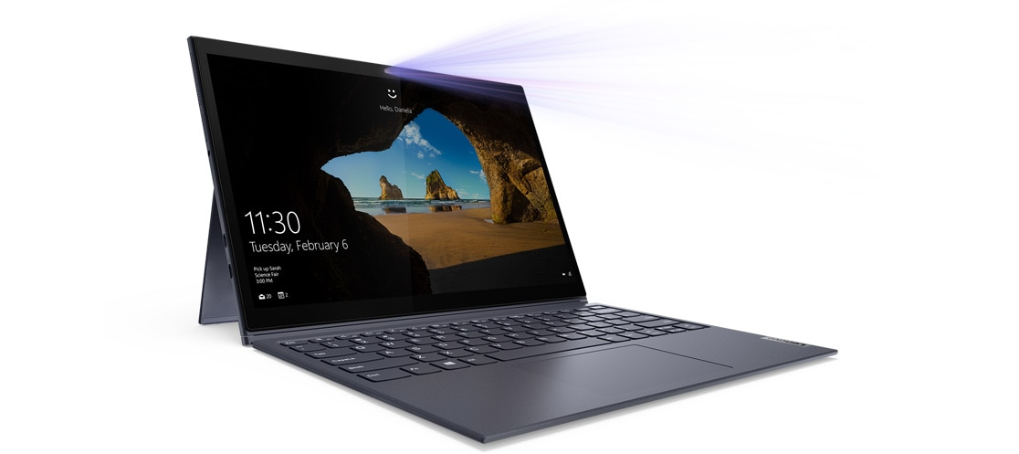 An open Yoga Duet 7i, showing the Windows 10 Home screensave and the date and time
