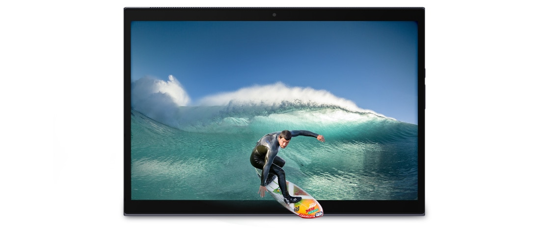 A Yoga Duet 7i in tablet mode, showing an ocean and a surfer appear to be surfing out of the screen
