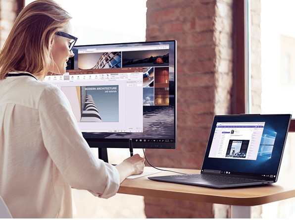 Lenovo Yoga S940 laptop, connected to large monitor in workplace setting