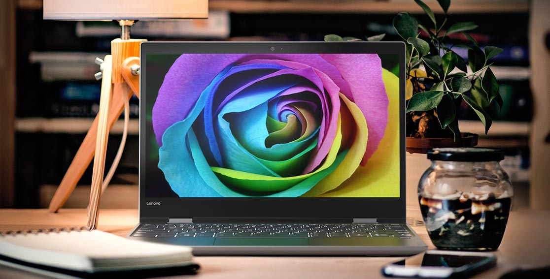 Lenovo Yoga 720 (12) on a work table showing colorful flower on display