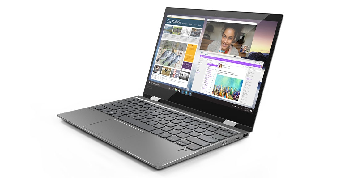 Lenovo Yoga 720 (12) in laptop mode, with numerous applications open on display