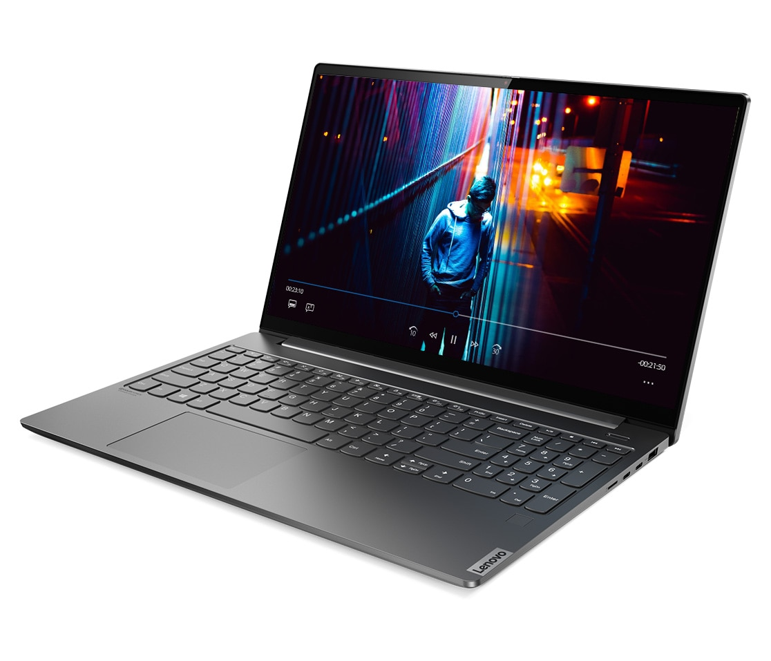 Side view of the Lenovo Yoga S740, with display open showing a young man walking at night
