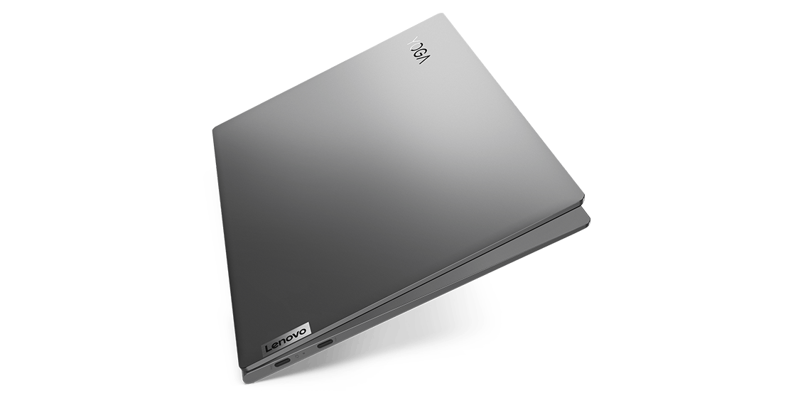 """Front view of Yoga Slim 7i (13""""), opened slightly with close-up of Yoga logo."""