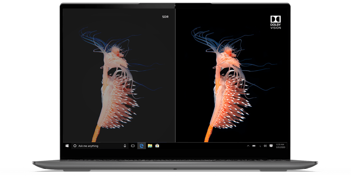 """Headshot of Lenovo Yoga Slim 7i (13"""") laptop showing a split screen with half in Dolby Vision and half in standard color."""