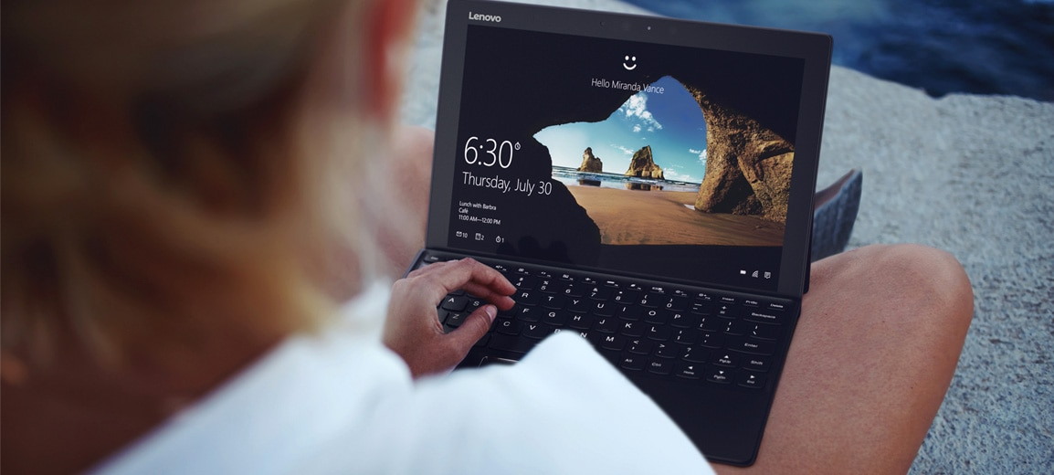 Lenovo Miix 720 featuring Windows Cortana being used outdoors