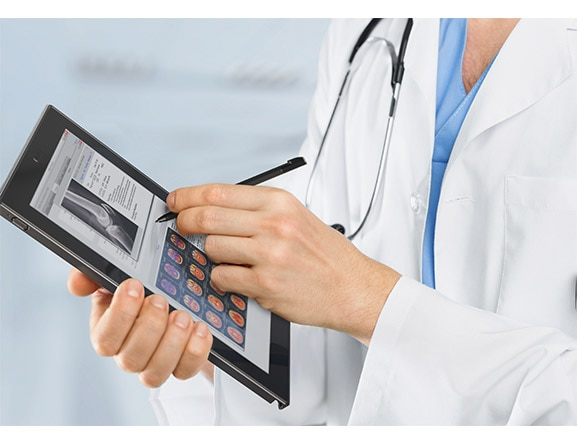 Lenovo Tablet 10 - business tablet - image of tablet being used with Lenovo Active Pen in medical setting