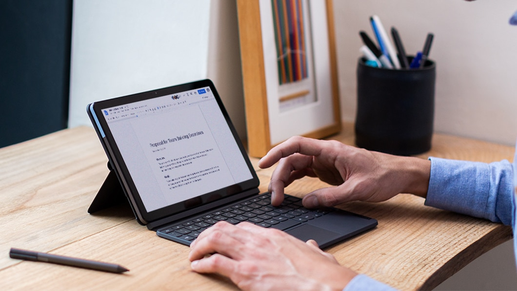 The IdeaPad Duet Chromebook with a proposal being written in Google Docs