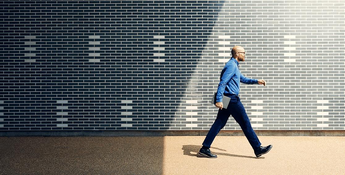Lenovo Yoga Book C930 held by walking man