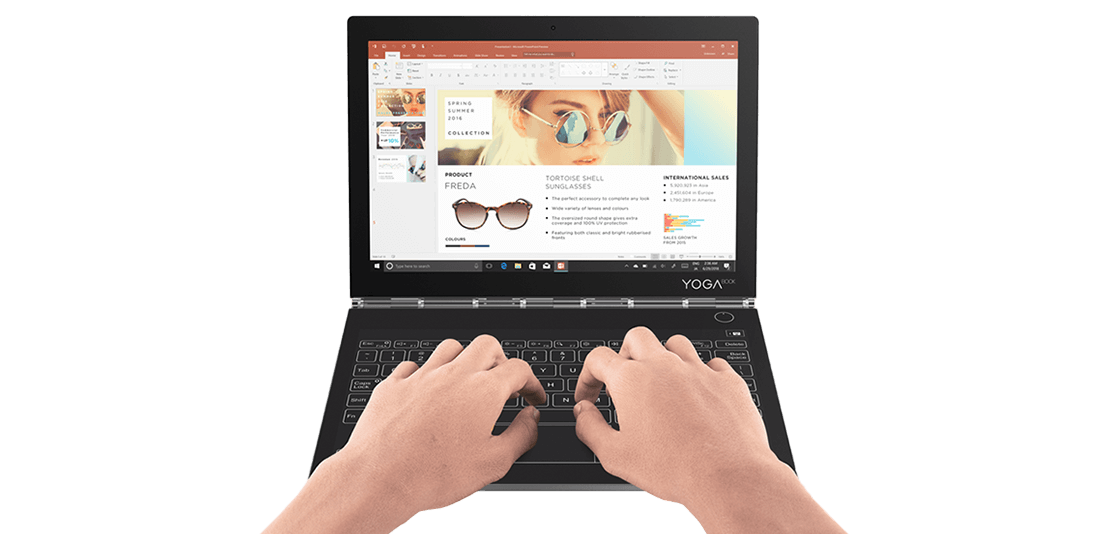 Lenovo Yoga Book C930 front view with hands typing on keyboard.