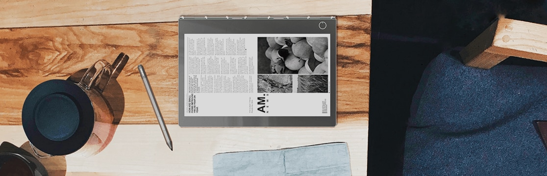 Lenovo Yoga Book C930 in tablet mode on top of wooden coffee table.