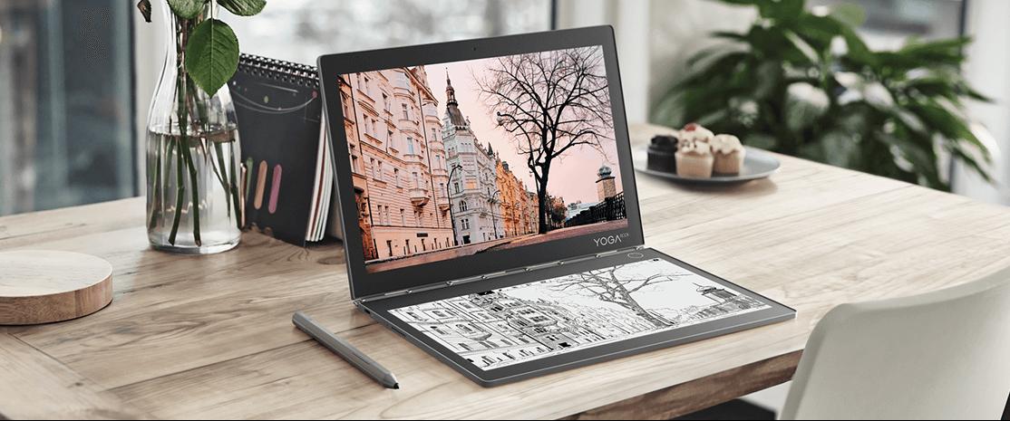 Lenovo Yoga Book C930 in laptop mode on wooden desk, front left side view.