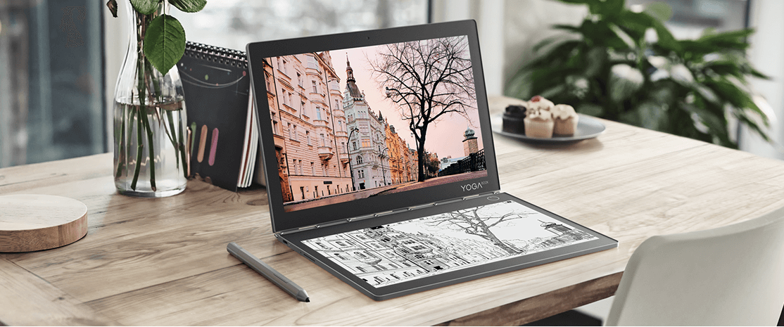 Lenovo Yoga Book C930 in laptop mode on wooden desk, front left side view.