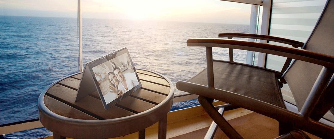 Lenovo Yoga Book C930 in stand mode, on balcony overlooking ocean.