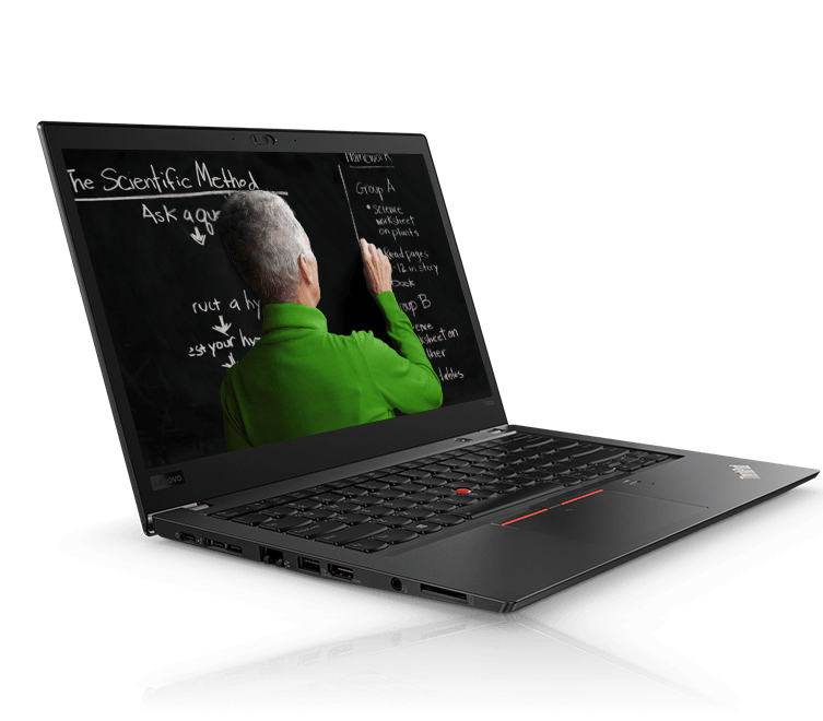 Lenovo ThinkPad T480s angled slightly left, opened about 95 degrees, showing the back of someone's head and right hand writing on a chalkboard