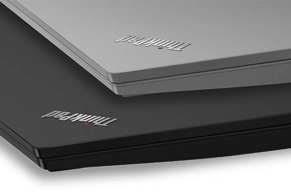 Two Lenovo ThinkPad E590 laptops stacked, showing both Silver and Black.