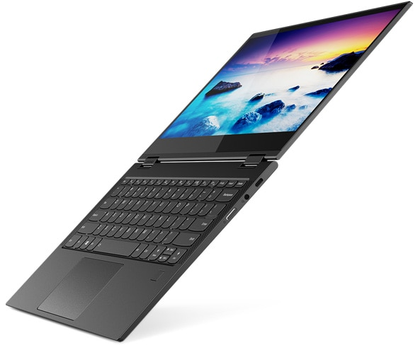 Side on view of the Yoga C630 at an angle, showing the screen on and folded flat, in line with the keybaord.