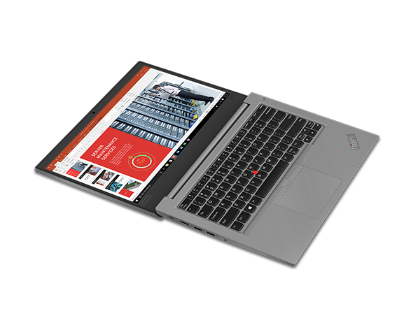 Lenovo ThinkPad E490 laptop in Silver, open 180 degrees laying flat (model shown is with optional fingerprint reader).